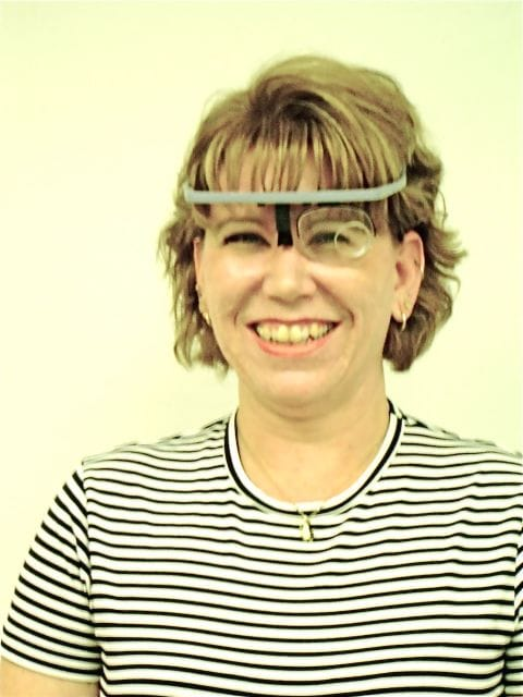 Woman wearing Prism Glasses